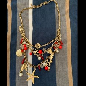 3/$12. Sea themed gold necklace
